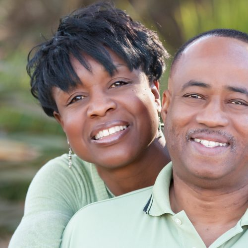 Attractive and Affectionate African American Couple Having Fun in the park.